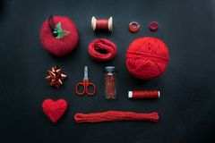 Red Sewing kit accessories and equipment for sewing and Needlework. Various tools for needlework: pin cushion for needles, thread. S, scissors, buttons, beads stock photo
