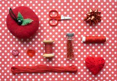 Red Sewing kit accessories and equipment for sewing and Needlework. Various tools for needlework: pin cushion for needles, thread. S, scissors, buttons, beads stock photos