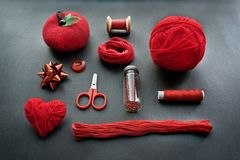 Red Sewing kit accessories and equipment for sewing and Needlework. Various tools for needlework: pin cushion for needles, thread royalty free stock photos