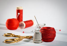 Red sewing kit, landscape. A sewing kit in red with pins, needles and scissors, landscape Stock Image