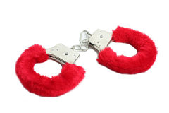 Red sexual handcuffs. Sexshop isolated on white background Stock Image