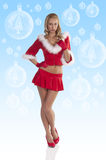 Red sexy christmas girl full body. Sexy and beautiful blond young woman wering a red christmass dress with hood and fur playing full body photo Royalty Free Stock Image