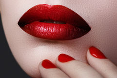 Red Lips and Nails closeup. Open Mouth. Manicure and Makeup Royalty Free Stock Photos