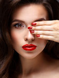 Red Sexy Lips and Nails closeup. Open Mouth Royalty Free Stock Photo
