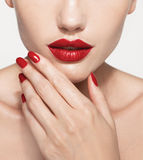 Red Sexy Lips and Nails closeup. Open Mouth. Royalty Free Stock Photo