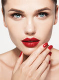 Red Sexy Lips and Nails closeup. Open Mouth. Royalty Free Stock Image