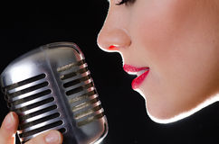 Red sexy lips and retro silver microphone Royalty Free Stock Images