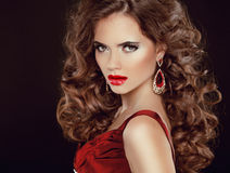 Red sexy lips. Stare. Beauty Brunette Girl Model with luxurious Stock Photos
