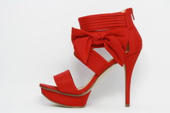 Red sexy party shoe. Pretty red high-heeled women's shoe with bow Royalty Free Stock Photos