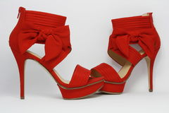 Red sexy party shoes. Pretty red high-heeled women's shoes with bows Royalty Free Stock Photos