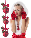 Red and sexy santa claus girl hiding under hood Royalty Free Stock Images