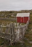 Red Shack. Stick fencing with a red shack Stock Photo
