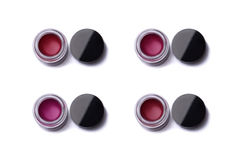 Red shade lip glosses in jars Royalty Free Stock Photo
