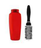 Red shampoo bottle and hairbrush Royalty Free Stock Image