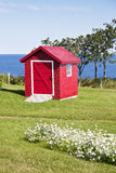 Red Shed. Red garden shed overlooking the ocean Stock Photo
