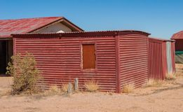 The red shed. Birdsville, a Queensland town on the edge of the Simpson Desert, is an  and desloate place. The red shed is showing signs being in a town with Stock Image