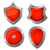 Red shield icons of different shapes Stock Photos
