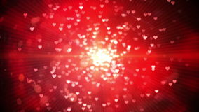 Red shimmering hearts on black background stock video footage