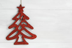 Red shine christmas tree on white wooden background Royalty Free Stock Photo