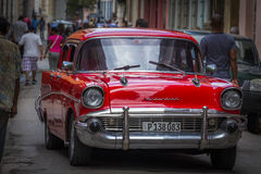 Red shining classic Chevrolet car in Havana, Cuba stock photography