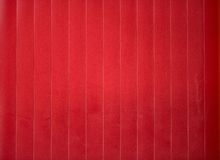 Red shining metal fence in the shadow Stock Photo