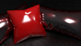 Red shinny leather pillow. Shinny synthetic leather red and dark pillows Royalty Free Stock Photos