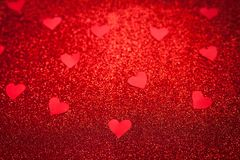 Red shiny background with red little hearts, love, Valentine`s Day, texture abstract background, suitable for ads,. Insert text royalty free stock photo