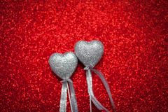Red shiny background with silver hearts, love, Valentine`s Day, texture abstract background, romantic picture, suitable for adver. Tisement, insert text stock image