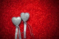 Red shiny background with silver hearts, love, Valentine`s Day, texture abstract background, romantic picture, suitable for adver Stock Photo