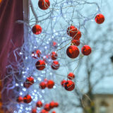 Red shiny balls on Christmas street in Paris, France Royalty Free Stock Images