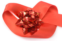 Red Shiny Bow with Stars on Heart Ribbon Stock Photography