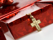 Red shiny box with cross on chain Stock Photo