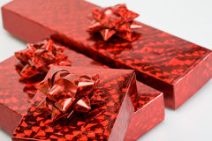 Red shiny boxes with red ribbons Royalty Free Stock Photography