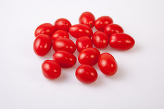 Red shiny cherry tomatoes Stock Image