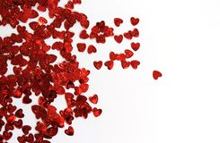 Red shiny confetti hearts on a white background royalty free stock photos