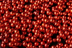 Red shiny costume jewelry  backgrou Royalty Free Stock Image