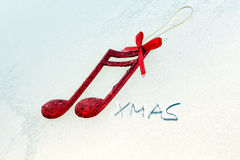 Red shiny decorative christmas music notes Royalty Free Stock Photo