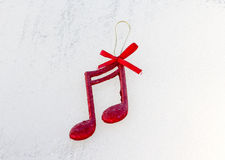 Red shiny decorative christmas music notes Stock Photography