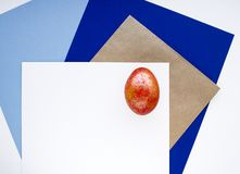 Red shiny egg. Happy Easter. Geometric background. royalty free stock photography