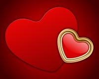 Red shiny heart shape on card Stock Photos
