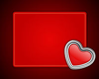 Red shiny heart shape on card Stock Images