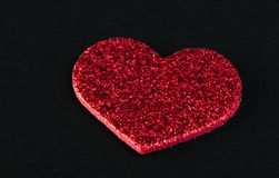 Red shiny hearts on black background Stock Image