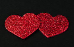 Red shiny hearts on black background Stock Photography