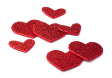 Red shiny hearts on white background Royalty Free Stock Photography