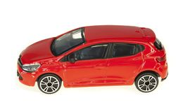 Red and shiny toy car. Isolated stock photo