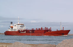 Red Ship. Large red ship steaming through a narrow channel Royalty Free Stock Image