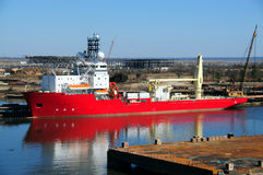 Red ship. A large red ship docked at a wharf Royalty Free Stock Photos