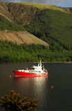 The red ship is in the harbor, Scotland Stock Photography