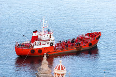 Red ship neat Malta Royalty Free Stock Photos