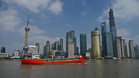 Red ship sails through downtown Shanghai,Lujiazui economic Center. Gh2_06821 stock video footage